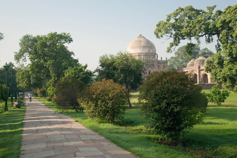 India, Delhi, Lodhi Gardens with Bada Gumbad tomb and mosque in background