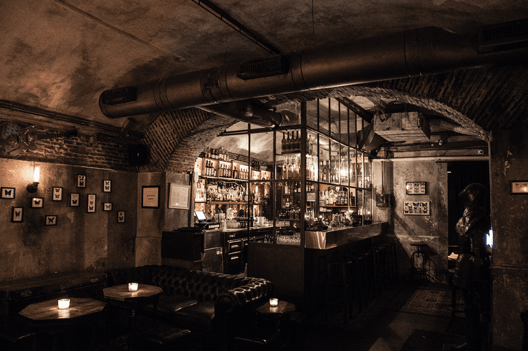 Club Derrière's dimly lit interior is perfect for a late-night drink