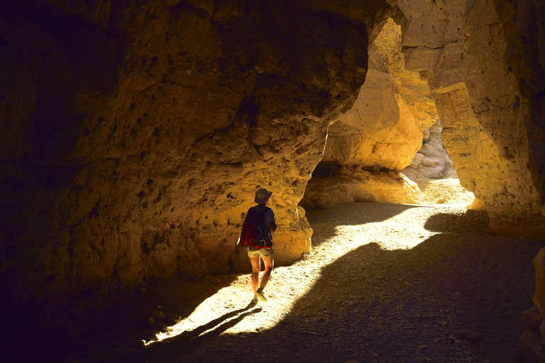 wanderer in the Sesriem canyon, Namibia, Namib Naukluft National Park