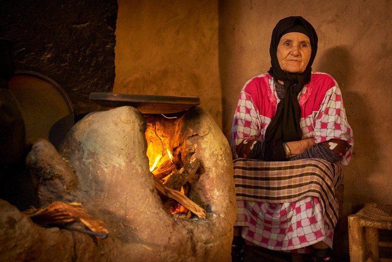 Old Berber women inside traditional Berber house. Ourica Valley, Morocco