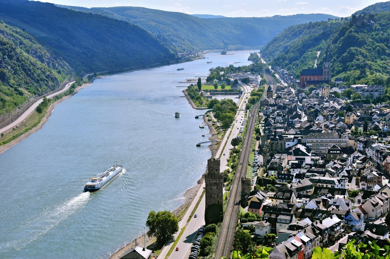 Town Oberwesel with town wall and watchtowers and the river Rhine, Upper Middle Rhine Valley, Germany.