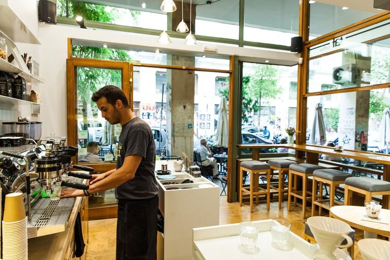 A waiter prepares coffee at Taf