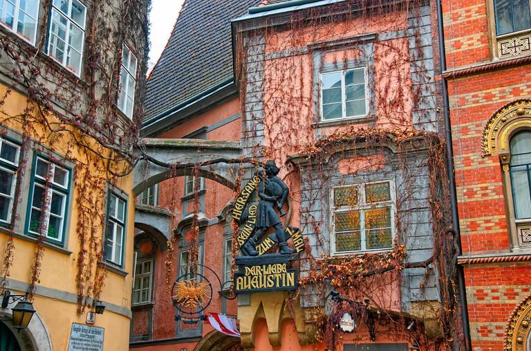 Vienna, Austria - January 8, 2014: Sign to Marx Augustin on the facade of Griechenbeisl, Vienna, Austria