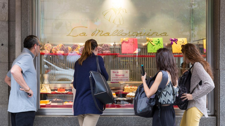 Customers window shopping at La Mallorquina in Madrid