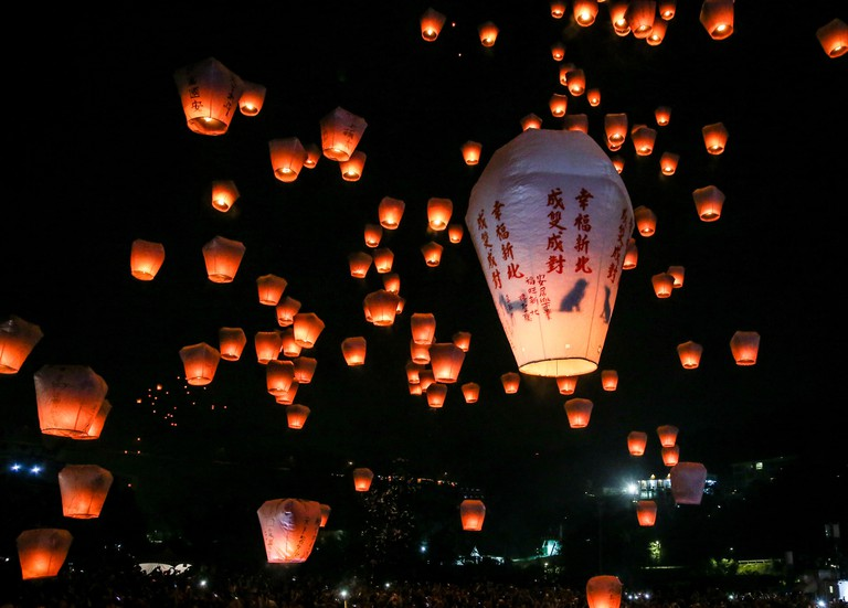 People release lanterns into the sky in hopes of good fortune and prosperity during the annual Pingxi Sky Lanter
