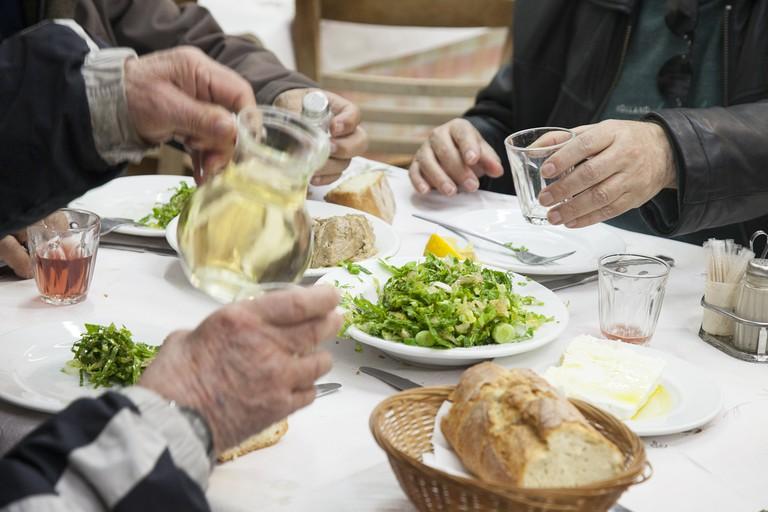 People eating at Anapsiktirio