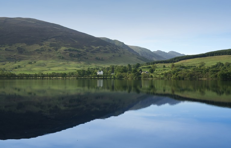 Loch Earn calm blue waters, highlands, Scotland.