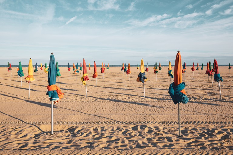 The famous colorful parasols on Deauville Beach, Normandy, Northern France, Europe