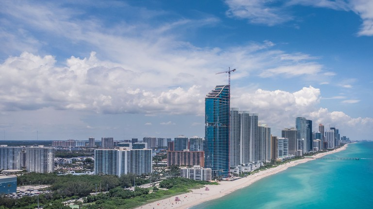 Aerial view, drone photography of Sunny Isles Beach City located in northeast Miami-Dade County, Florida in beautiful sunny day