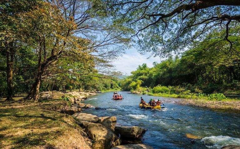 Nakhon Nayok, Thailand -  January 26, 2019 : Travelers rafting on the stream from Khun Dan Prakan Chon Dam on holidays