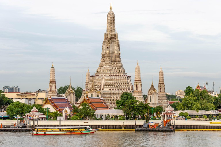 The landmark Wat Arun Buddhist Temple along the Chao Phraya River in Bangkok