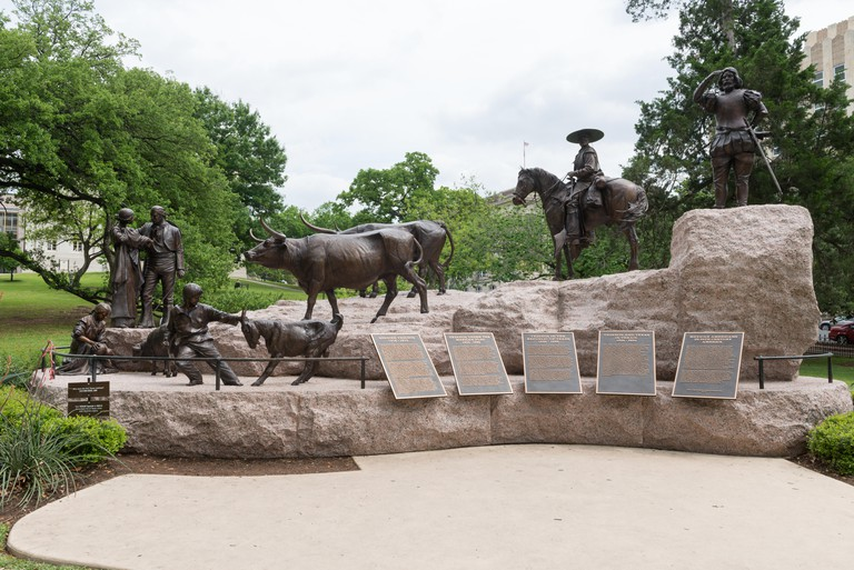 The  Tejano Monument, a sculpture on the Texas Capitol Grounds that salutes Texas's first cowboys, Spanish Tejanos from Spain's New World empire, then Mexico, and then Texas, as well as other Spanish-speaking settlers