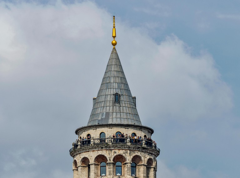ISTANBUL TURKEY THE GALATA TOWER IN KARAKOY DISTRICT PEOPLE ON THE VIEWING PLATFORM AT THE TOP OF THE TOWER