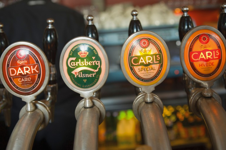 Denmark; Close-up of beer taps in bar Take in cozy pubs and trendy cosmopolitan bars to wild nightclubs on this pub crawl of pleasure.