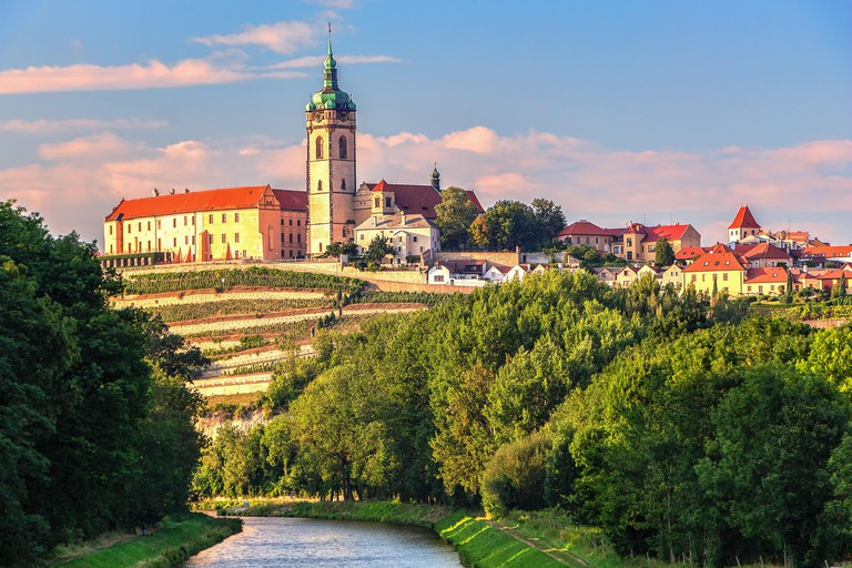 Panorama or skyline or cityscape of historical city Melnik with historical castle and river Vltava and famous vineyards. Melnik is 30 km north of Prag