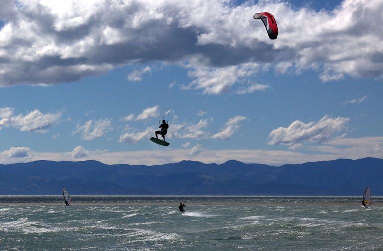 Kitesurfers in action at Tahunanui Beach