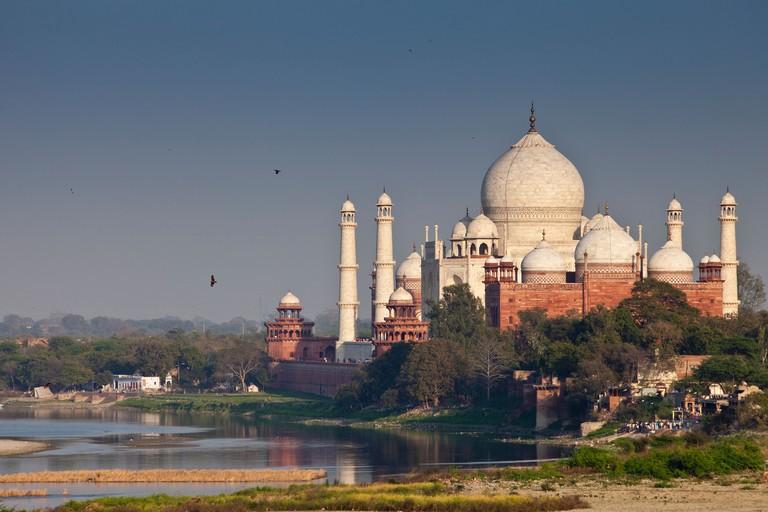 The Taj Mahal view and Yamuna River at sunset