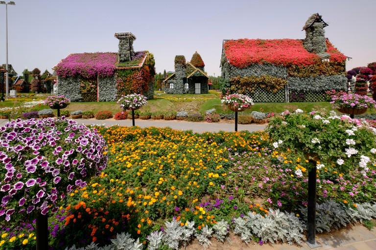 Houses covered in flowers at Miracle Garden Dubai
