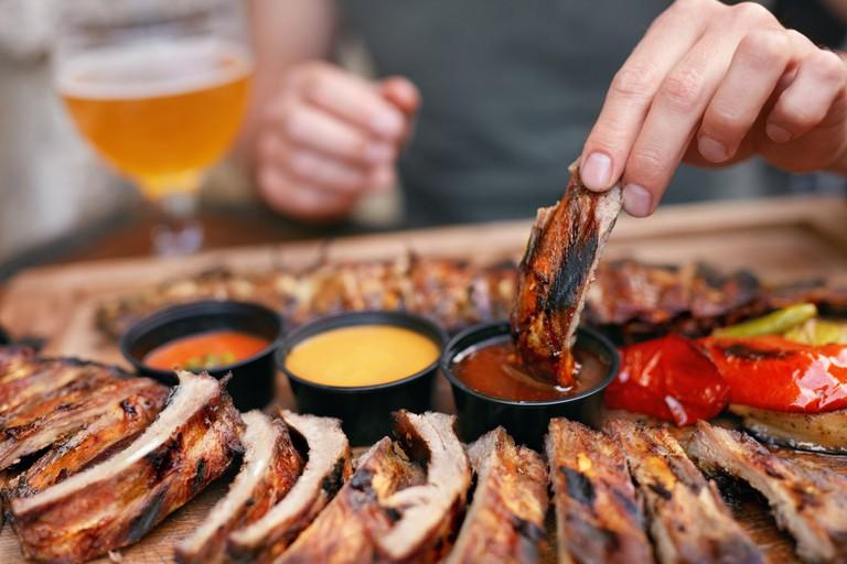 Barbecue Ribs With Sauсes Closeup
