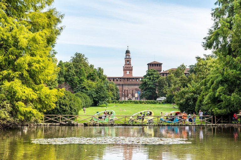 Tower of Sforza Castle (Castello Sforzesco), built in the 15th century by Francesco Sforza, Duke of Milan, and the park of Parco Sempione, a large city park in Milan, Italy.