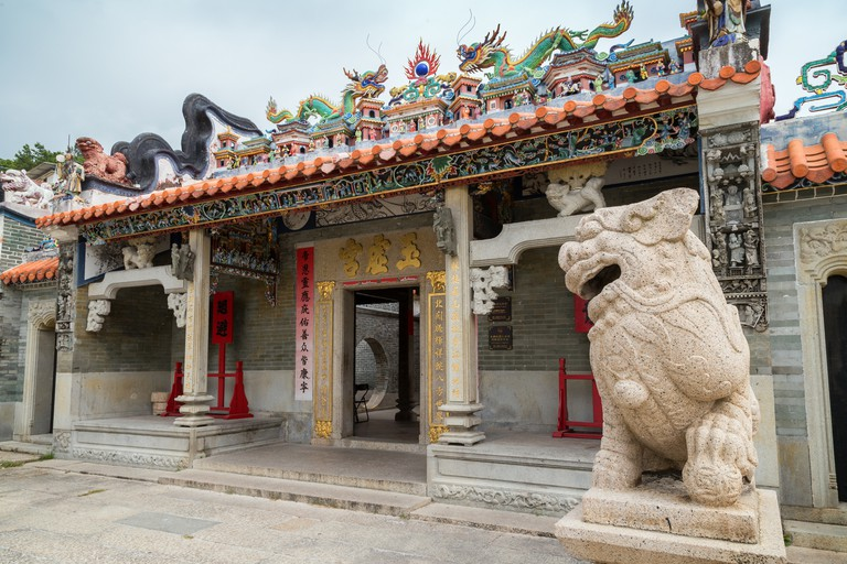 Statue and entrance to the decorated Pak Tai Temple on Cheung Chau Island in Hong Kong, China.