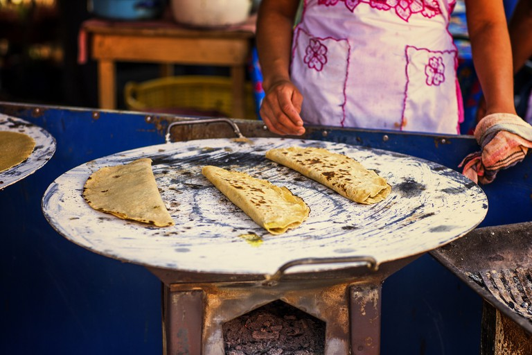 Mexican Quesadillas being made in a comal