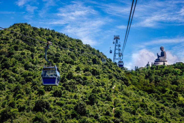 Ngong Ping cable car go to The Tian Tan Big Buddha statue statue , Hong Kong China