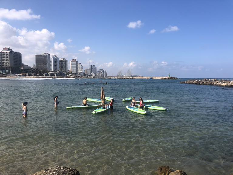 A paddle board yoga session