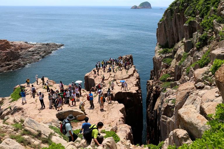 Hong Kong, China. 9th June, 2013. People visit Hong Kong UNESCO Global Geopark in Hong Kong, south China, June 9, 2013. Credit: Li Peng/Xinhua/Alamy Live News
