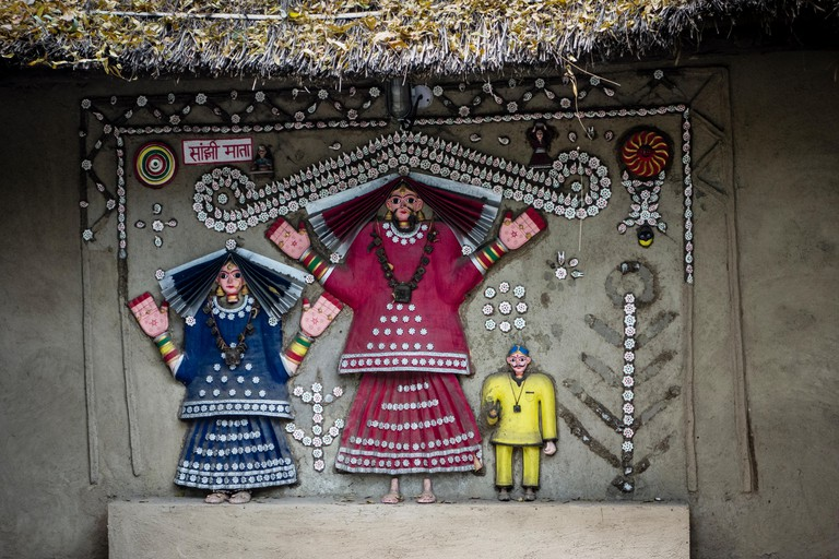 Exhibit of a wall painting with colorful figures in the National Crafts Museum, New Delhi, India