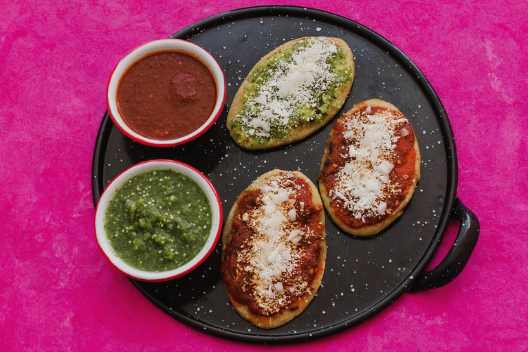 mexican tlacoyos with green and red sauce, Traditional food in Mexico