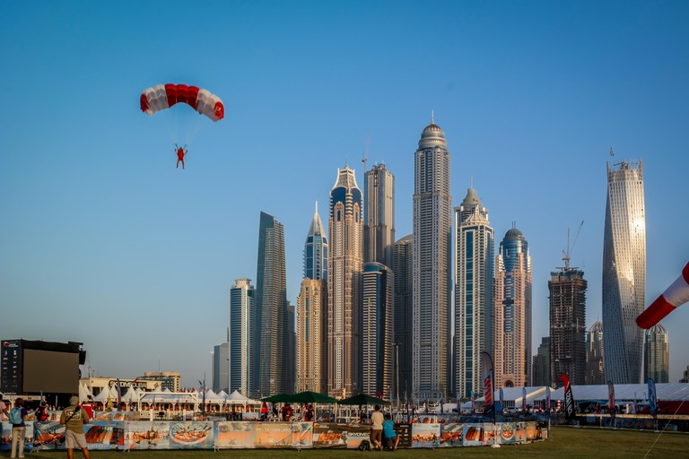 A skydiver above Dubai Marina