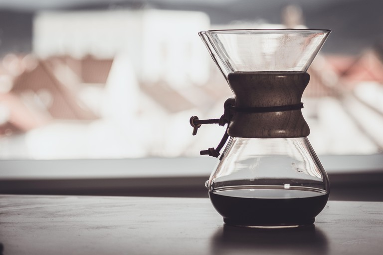 "coffee in style ""pour over"" in front of window, shallow depth of field"