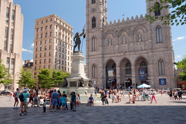 Tourists on Place d'Armes, Old Montreal, province of Quebec, Canada.