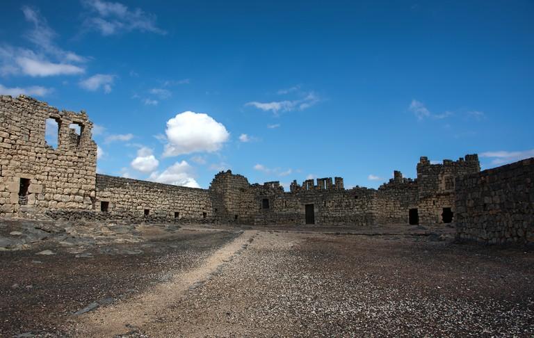 Desert castle Qasr al Azraq in eastern Jordan under clear blue s