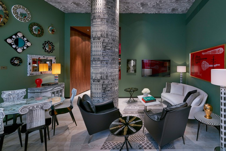 Suites feature bespoke furnishings and decorative pieces sourced from atelier Fornasetti's impressive collection