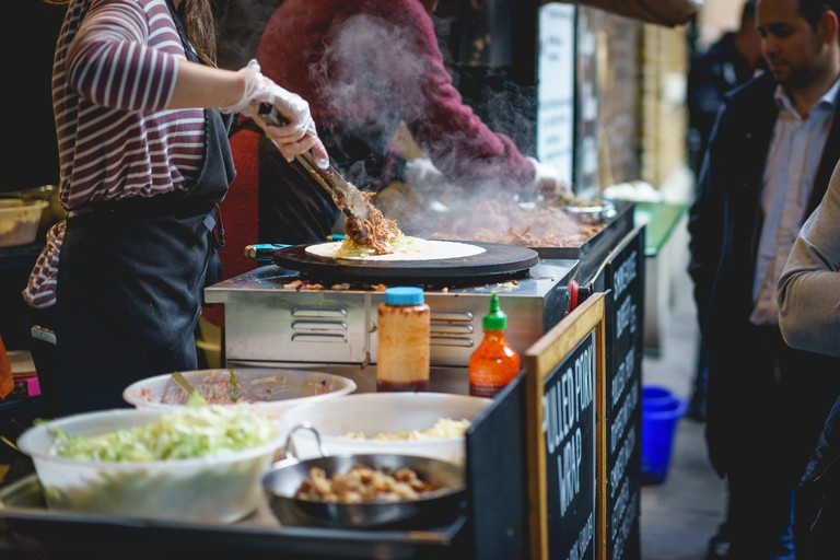 A stall preparing food in Borough Market, one of the oldest and largest food markets in London.