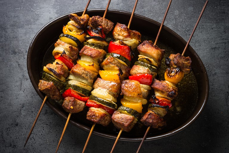 Grilled meat kebab with vegetables