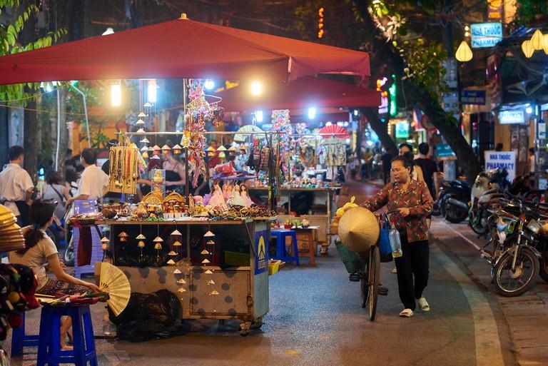 Night shot of Hanoi's Night Market in the Old Quarter, Vietnam.