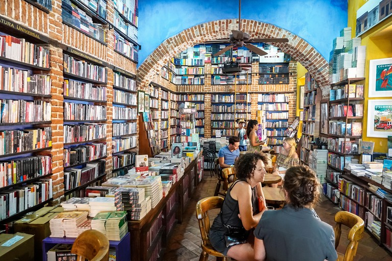 Cartagena Colombia Old Walled City Center centre Centro Abaco Libros y Cafe Abacus bookstore cafe interior bookshelf bookshelves exposed brick table d