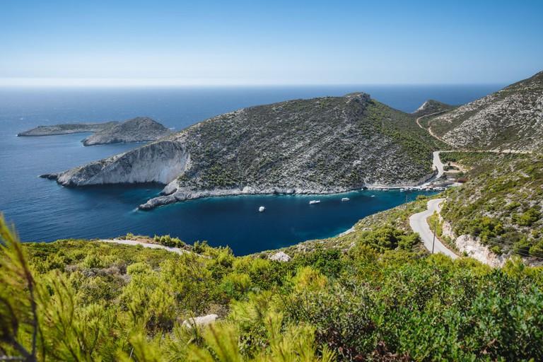 Porto Vromi. Ionian sea bay with moored and anchored boats. Zakynthos island sightseeing spot. Greece