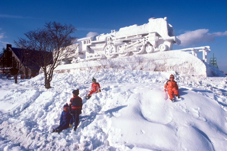 Children Playing at Snow Sculpture, Sapporo, Japan