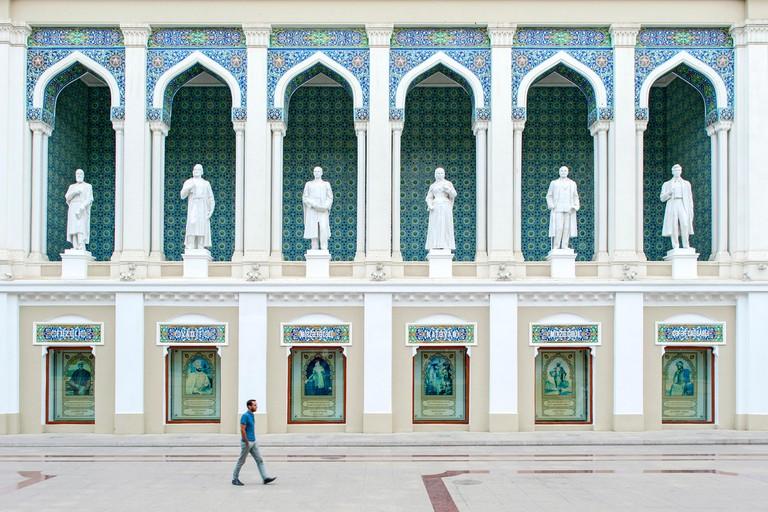 A man walking past the Nizami Museum of Azerbaijan Literature in Baku.