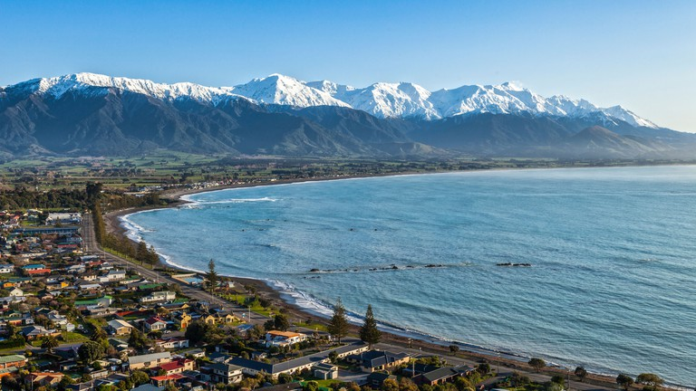 The Seaward Kaikoura Range and the town of Kaikoura on a clear spring morning. The town is an important tourist destination...