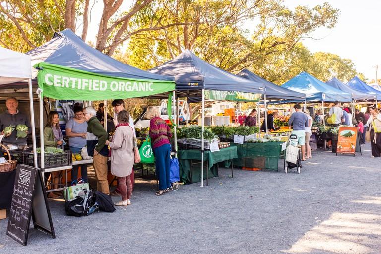Various stalls selling goods at Byron Bay Farmers Market, Byron Bay.