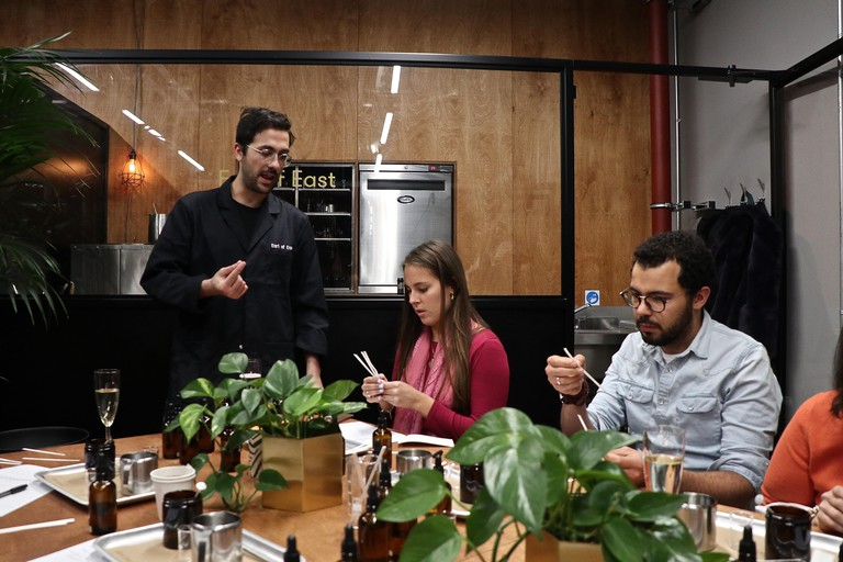 Coal Drops Yard candle making class Earl of East run a variety of workshops over the Christmas season these images are of a class learning how to make candles and create there own scents from essential oils and a candle from soy wax , they also offer Crac