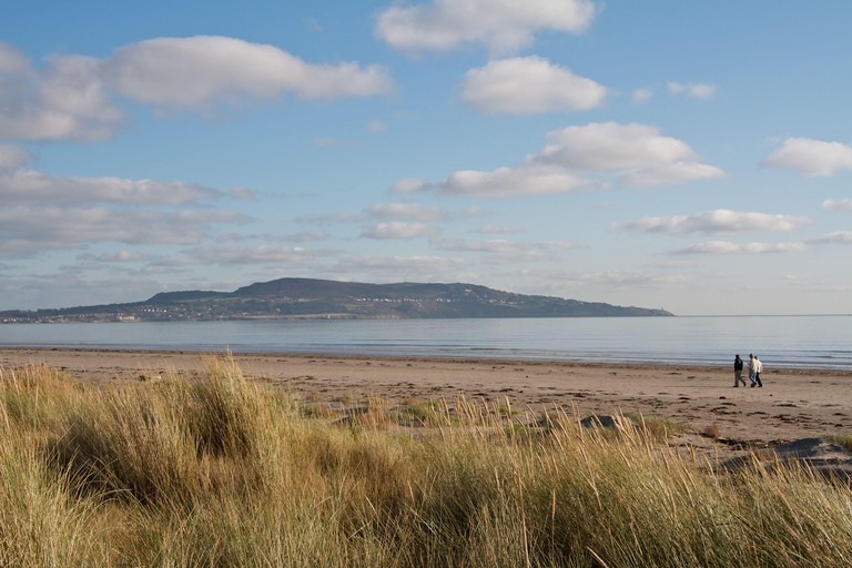 Dollymount Strand in Dublin Ireland. Howth Head can be seen in the distance.