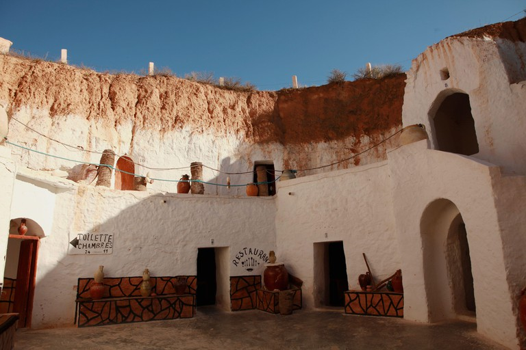 Patio and walls of an underground hotel Sidi Idriss in Matmata, Tunisia, where part of Star Wars movie was filmed.