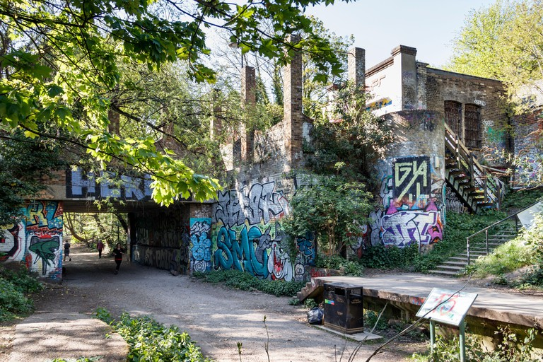Parkland Walk, a disused railway line, now a nature trail, used by joggers, walkers and cyclists, especially in the coronavirus lockdown, London, UK