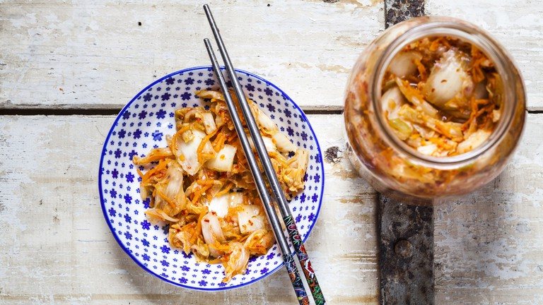Homemade kimchi with chinese cabbage, scallions and carrots
